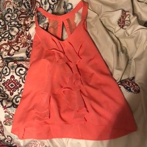 peach coloured lace and ruffed tank top